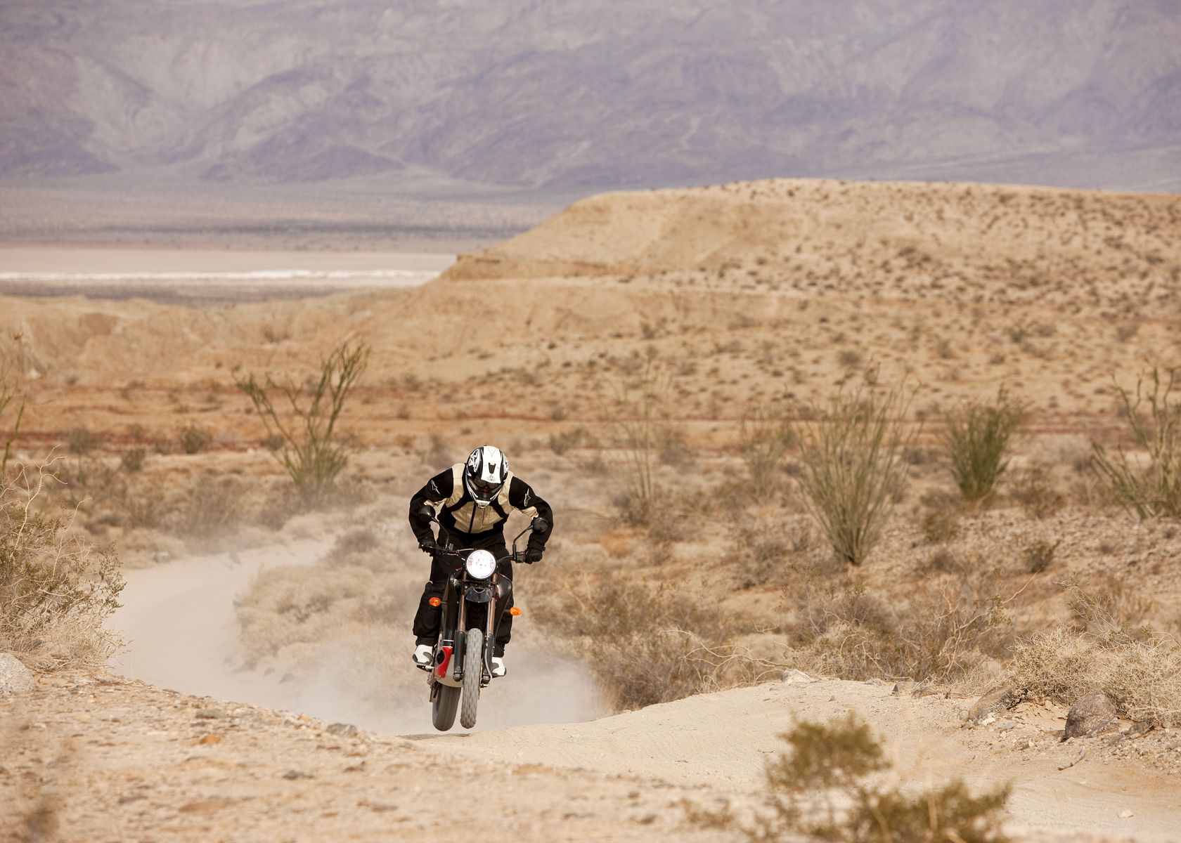 '.2010 Zero DS Electric Motorcycle: Anza Borego - One Man Charges in Sand.'