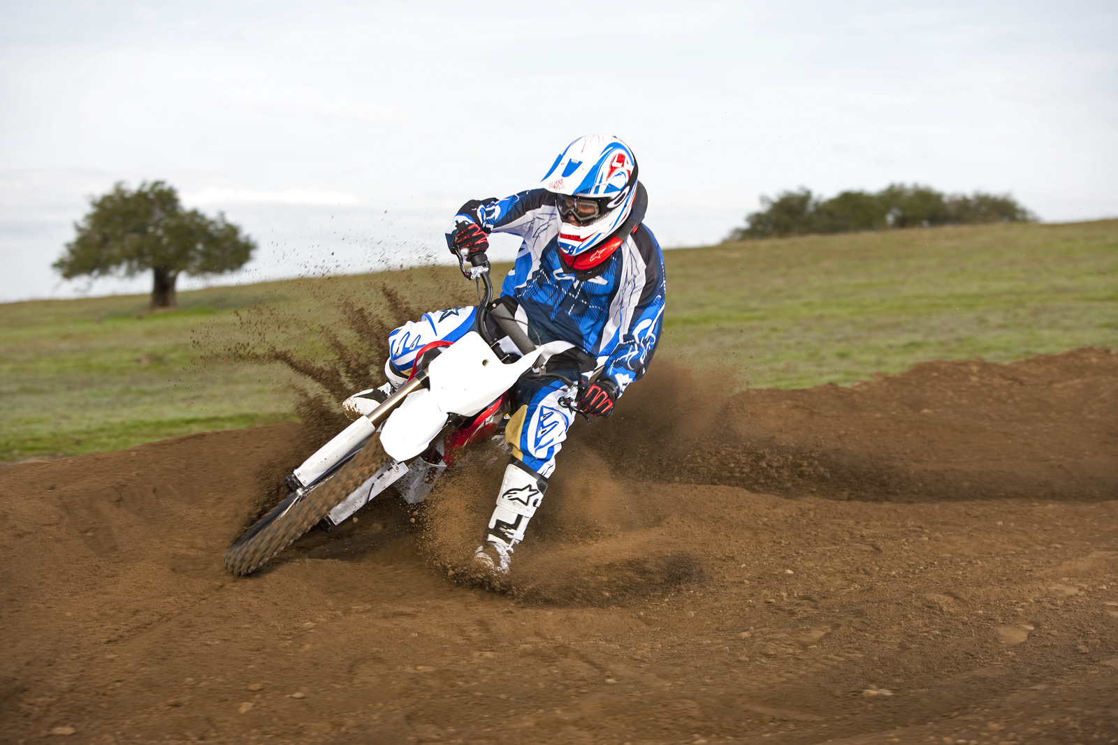 '.2010 Zero MX Electric Motorcycle: Zaca Station - Rider Hits Corner.'