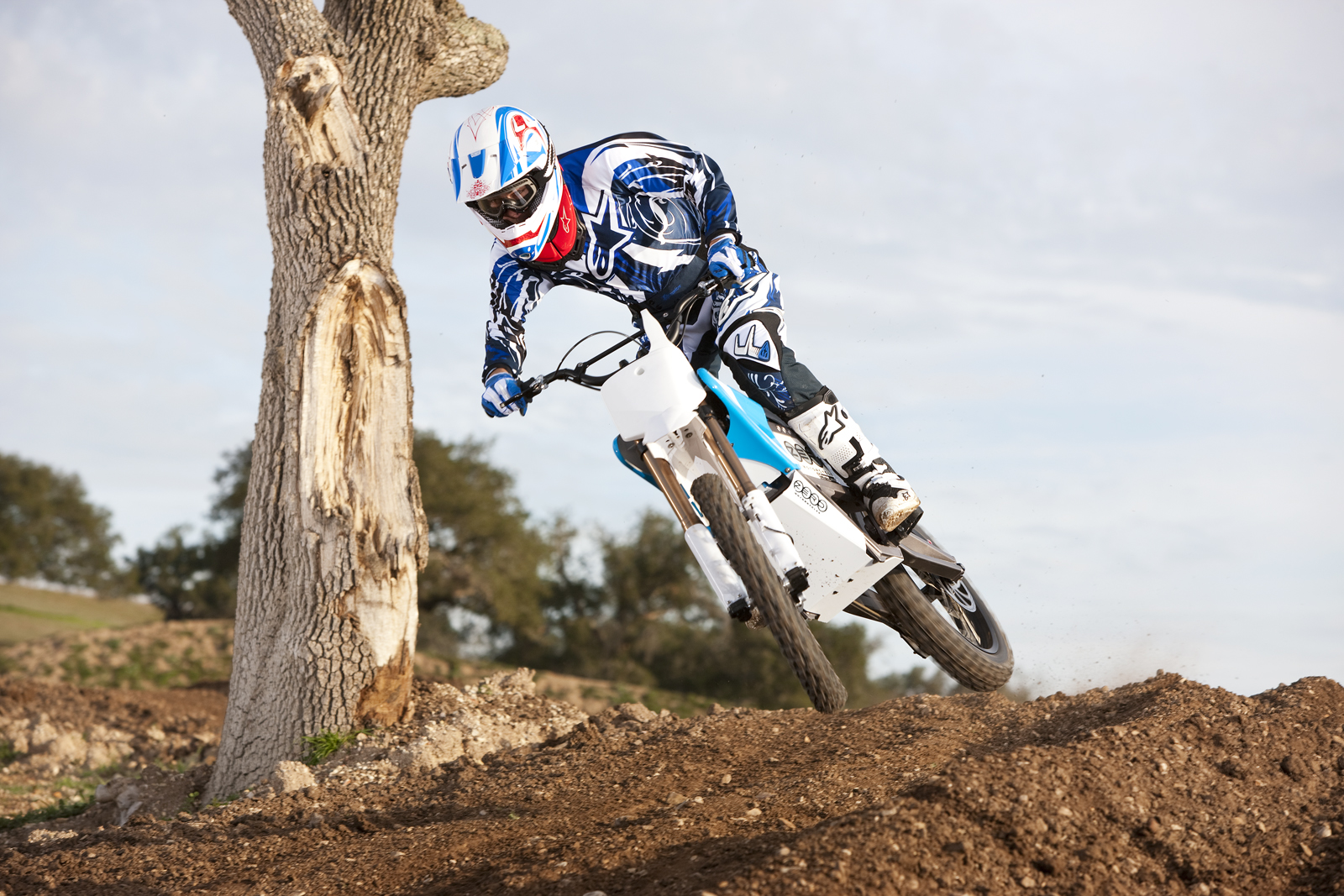 '.2010 Zero MX Electric Motorcycle: Zaca Station - Rider Jumps by Old Oak.'