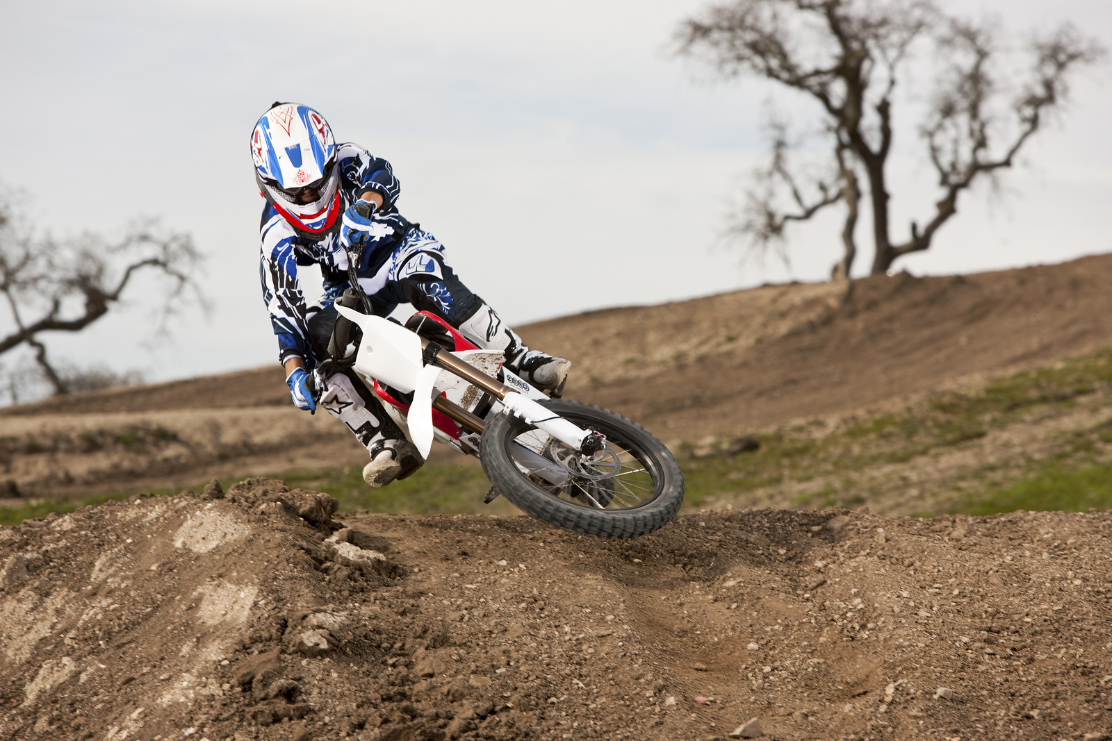 '.2010 Zero MX Electric Motorcycle: Zaca Station - Red Scrub Lean Left.'