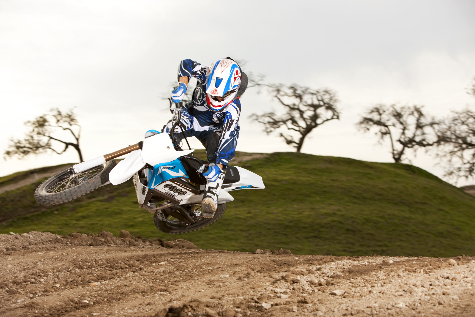 '.2010 Zero MX Electric Motorcycle: Zaca Station - Blue Scrub Lean Right.'