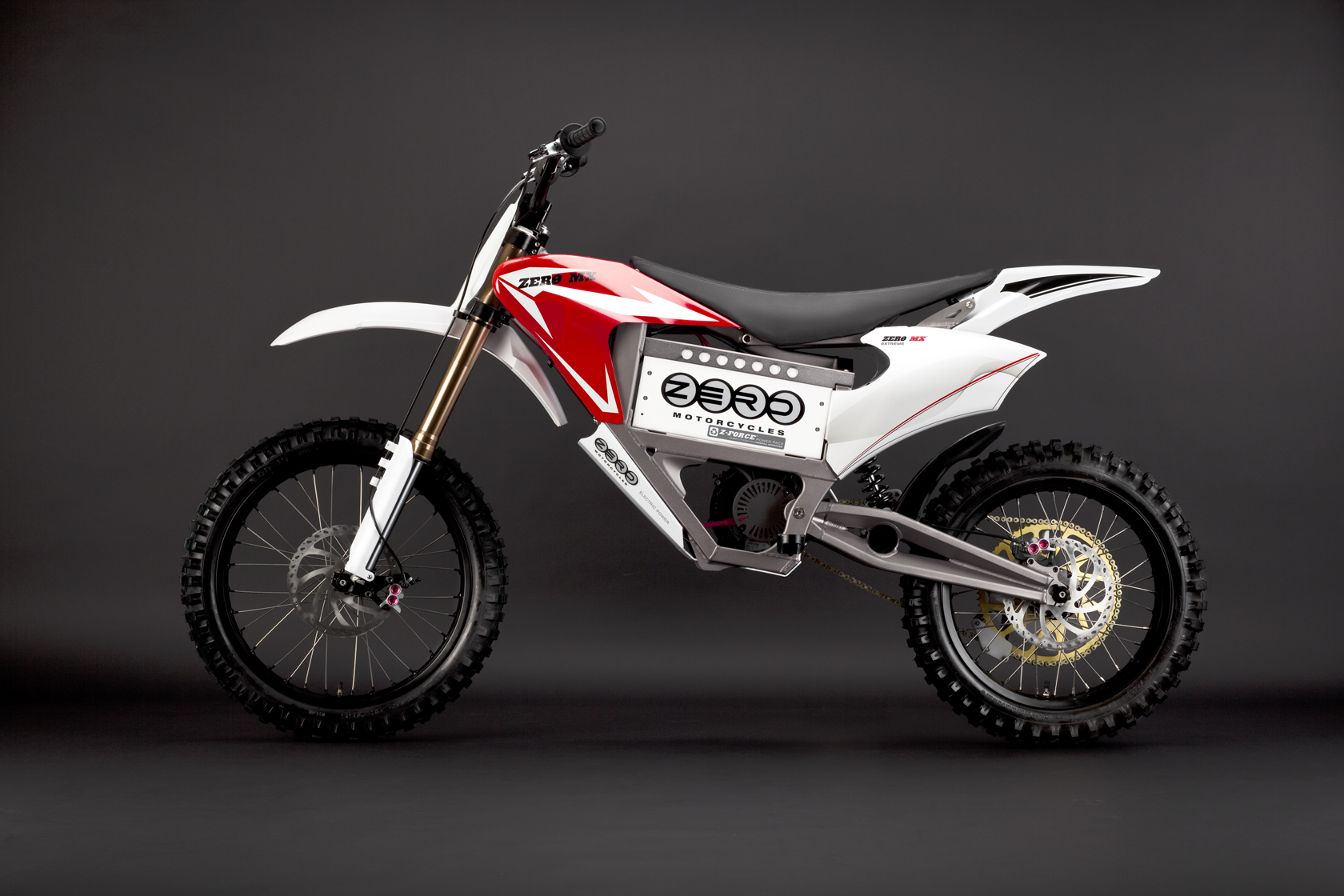 '.2010 Zero MX Electric Motorcycle: Red Profile Left.'