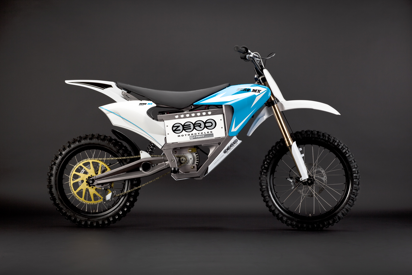 '.2010 Zero MX Electric Motorcycle: Blue Profile Right.'