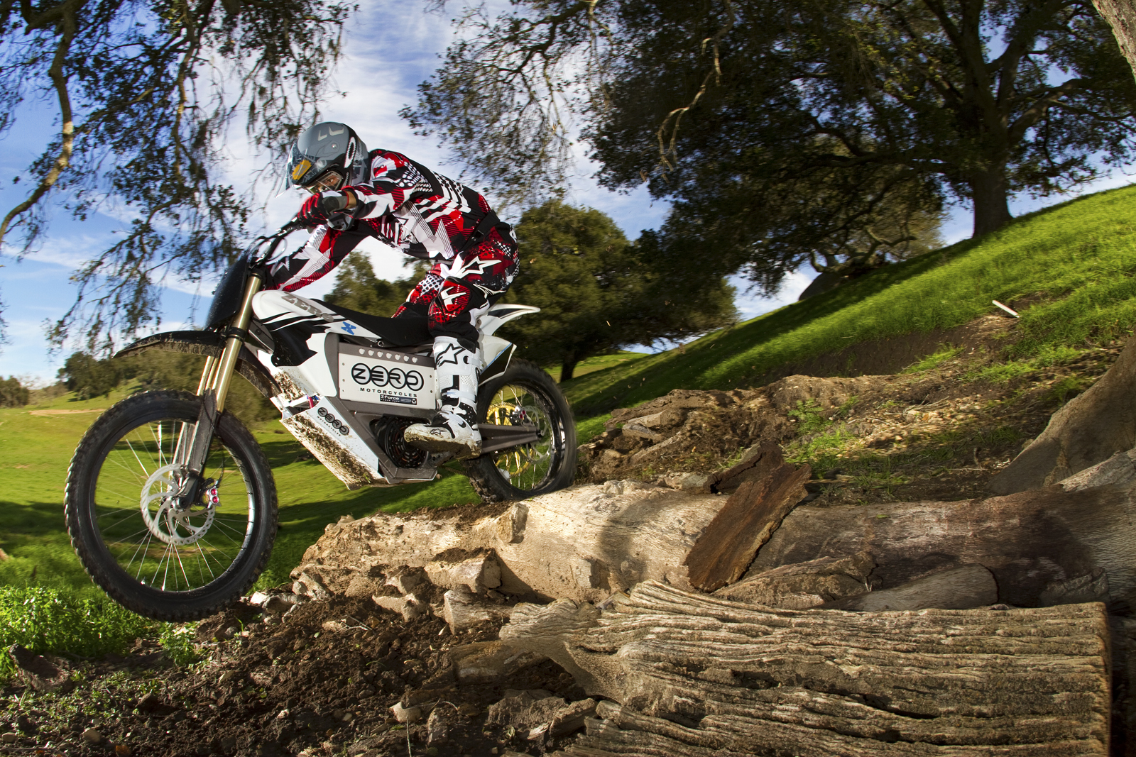 '.2010 Zero X Electric Motorcycle: Zaca Station - Trail over Log in Sun.'