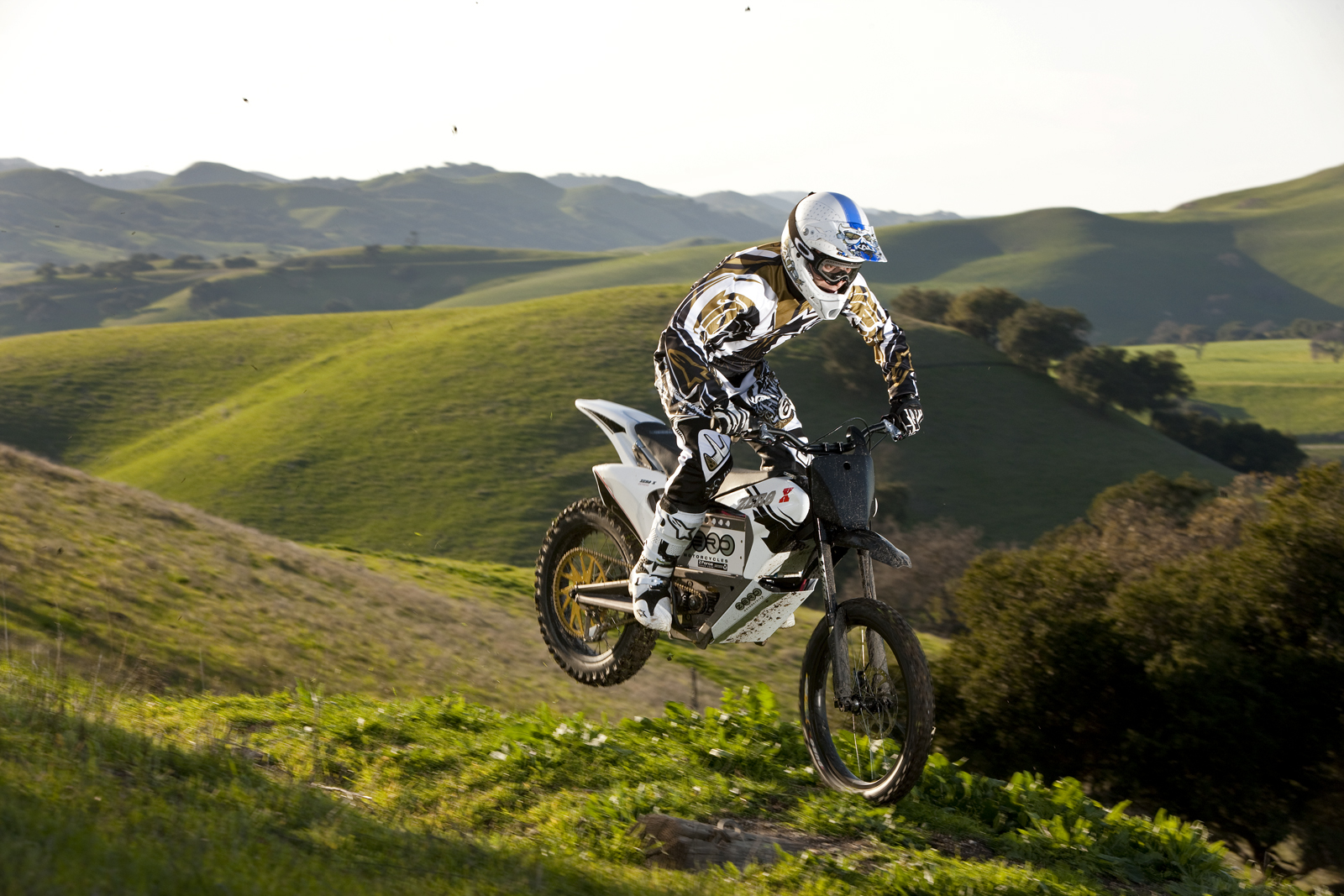 '.2010 Zero X Electric Motorcycle: Zaca Station - Wheelie on Ridge.'