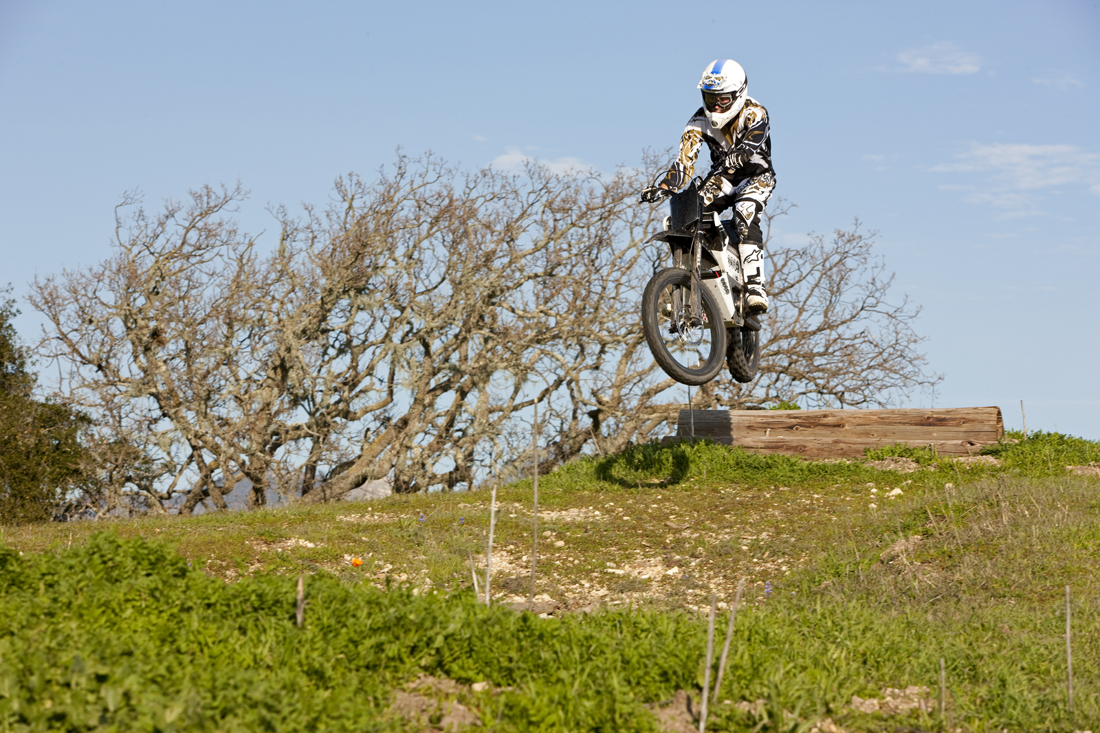 '.2010 Zero X Electric Motorcycle: Zaca Station - Jumps over Log.'