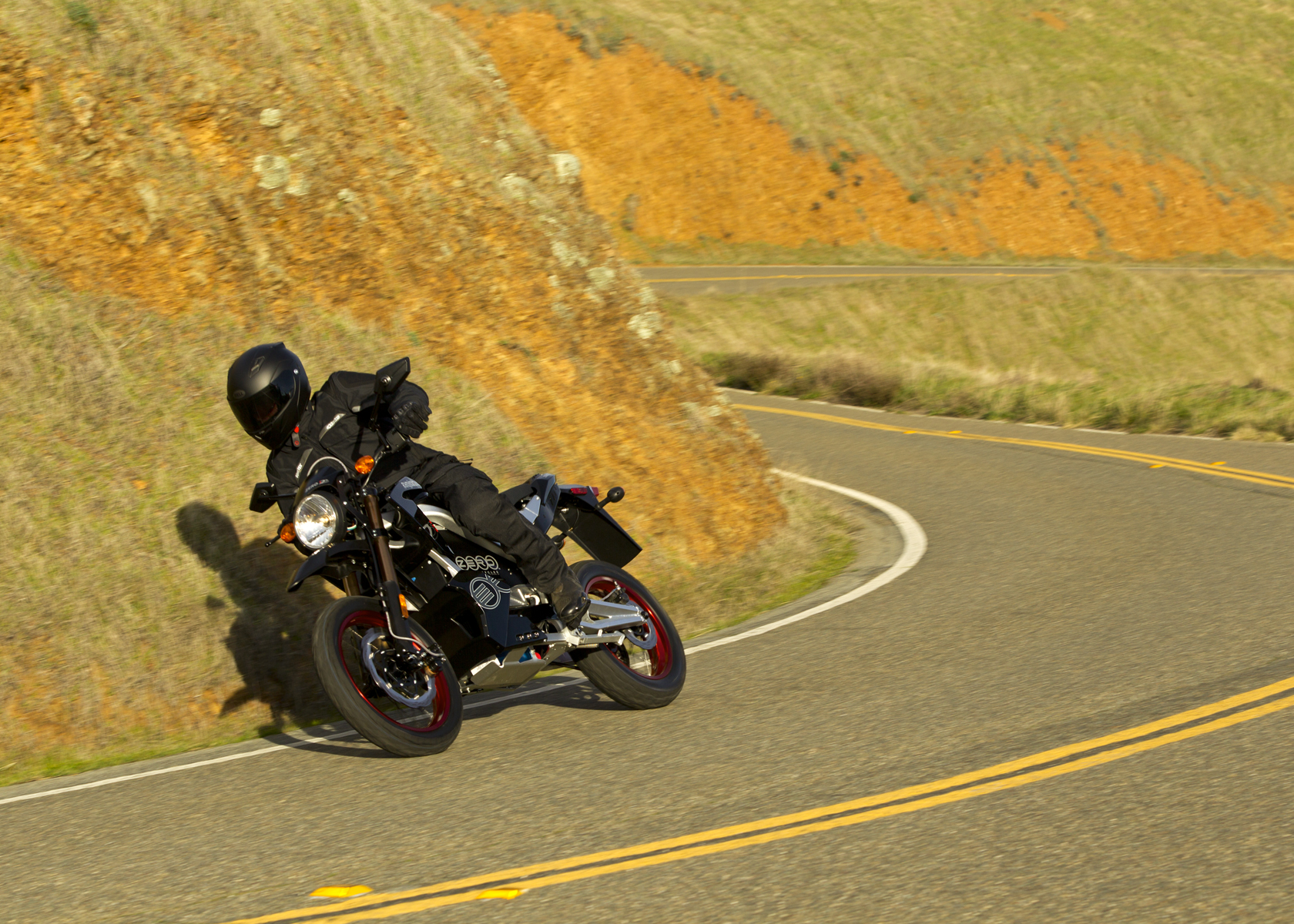 '.2011 Zero DS Electric Motorcycle: Yellow Hills, Lean Right.'