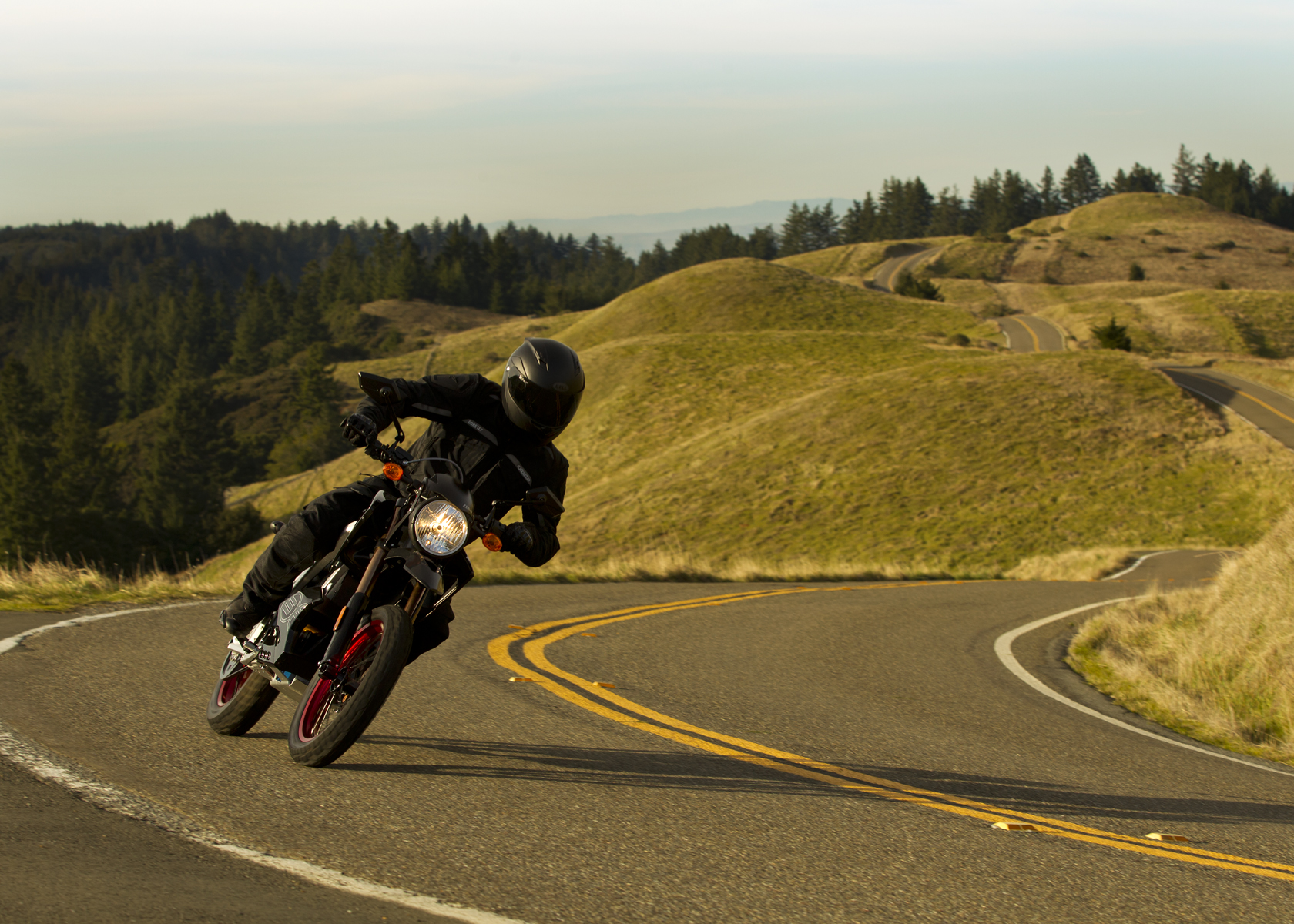 '.2011 Zero DS Electric Motorcycle: Yellow Hills, Lean Left.'