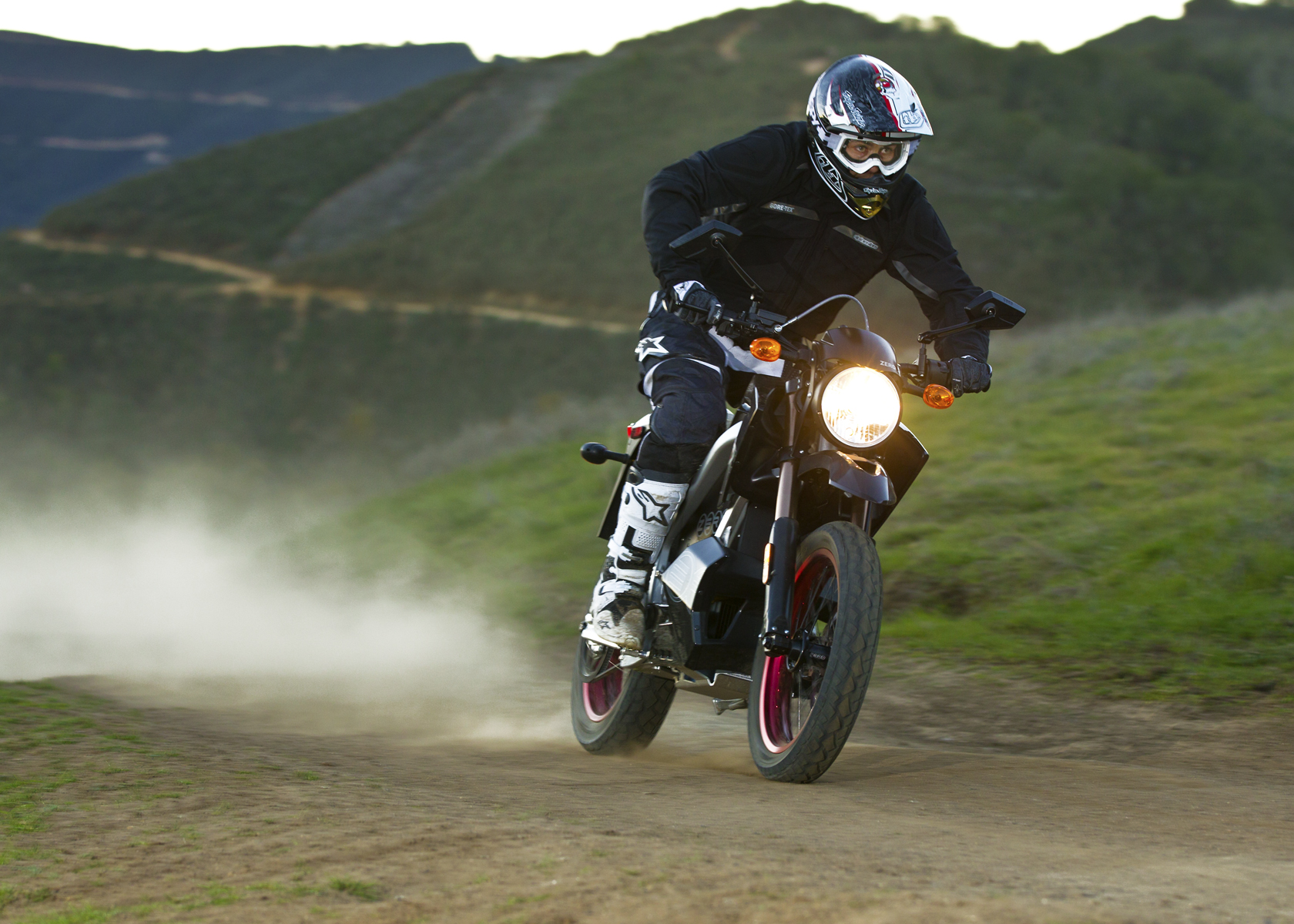 '.2011 Zero DS Electric Motorcycle: Charging Down a Dirt Road.'