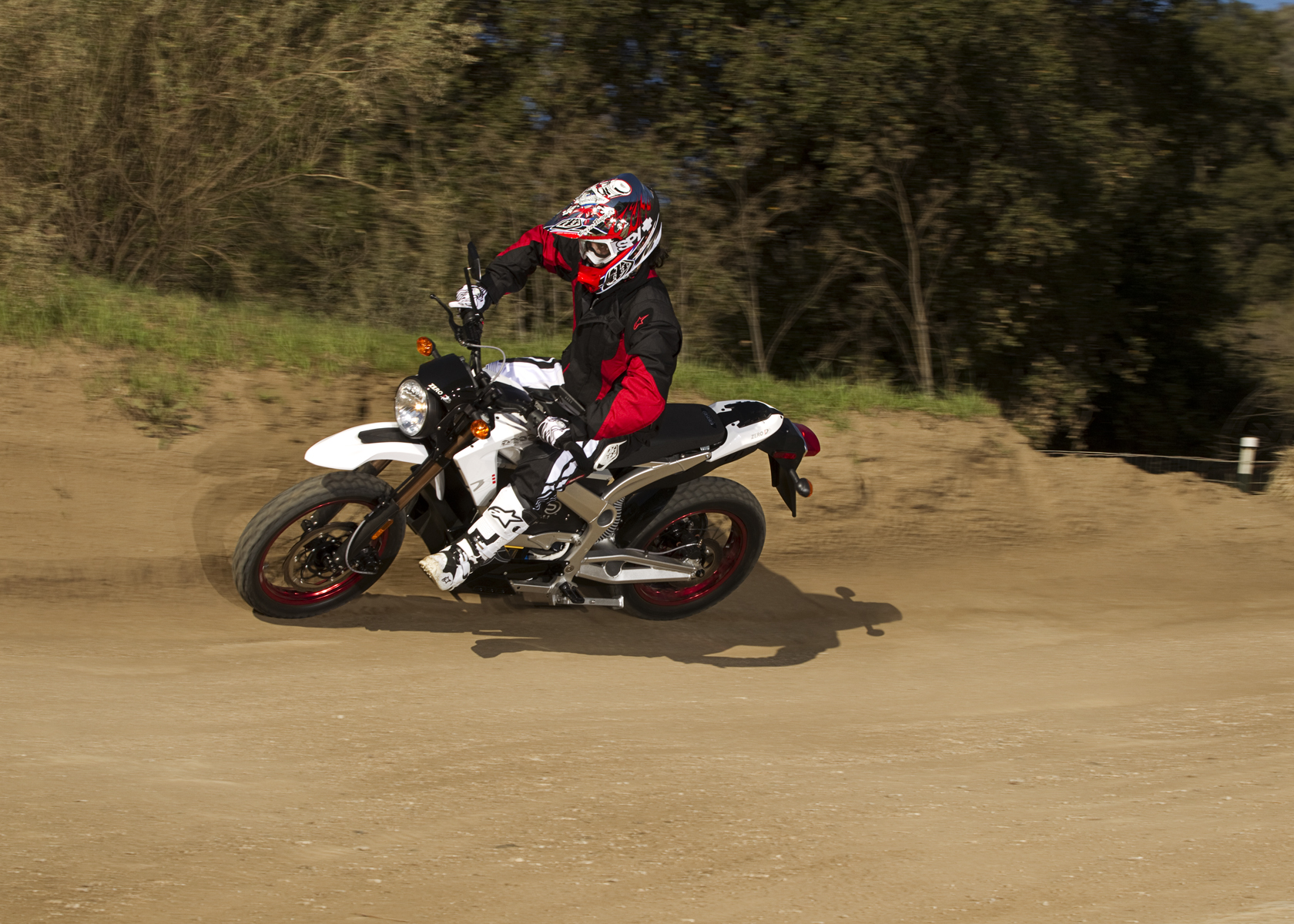'.2011 Zero DS Electric Motorcycle: Dirt Road, Corner.'