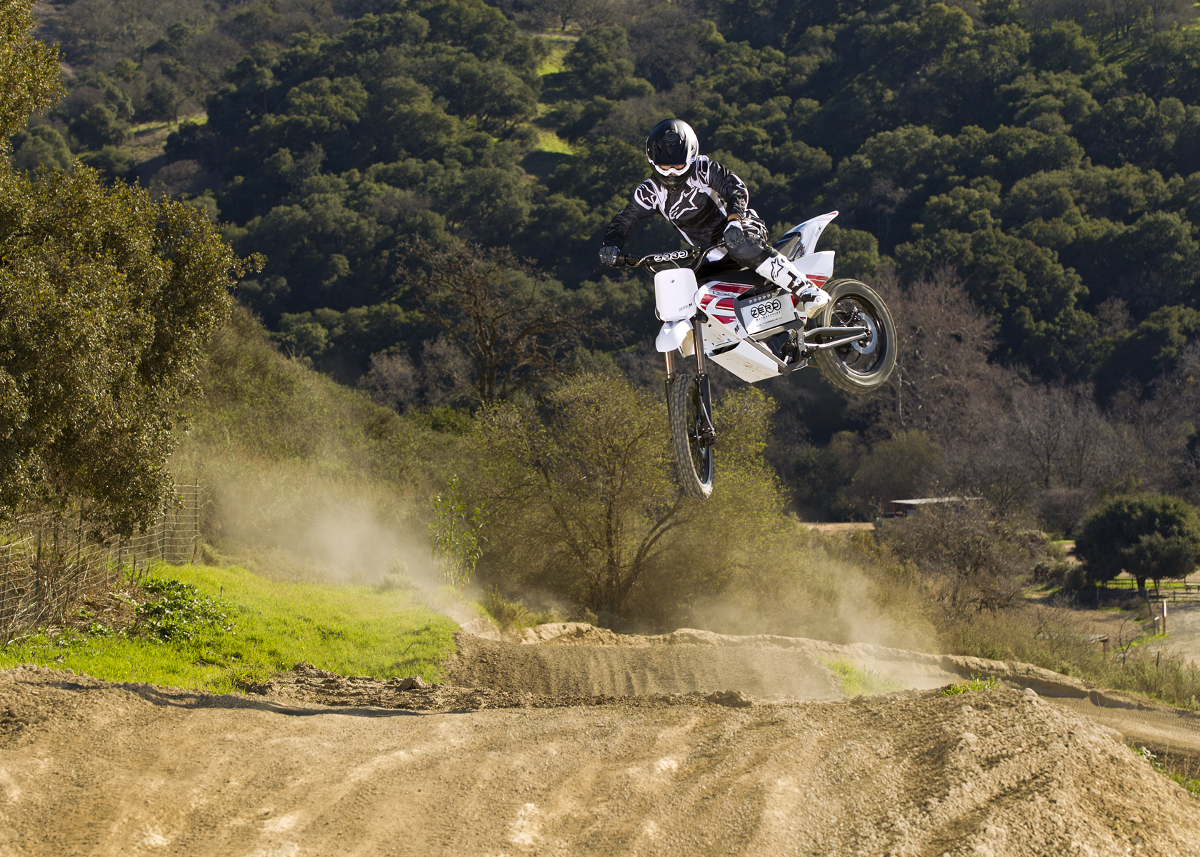 '.2011 Zero MX Electric Motorcycle: High Jump on Track.'