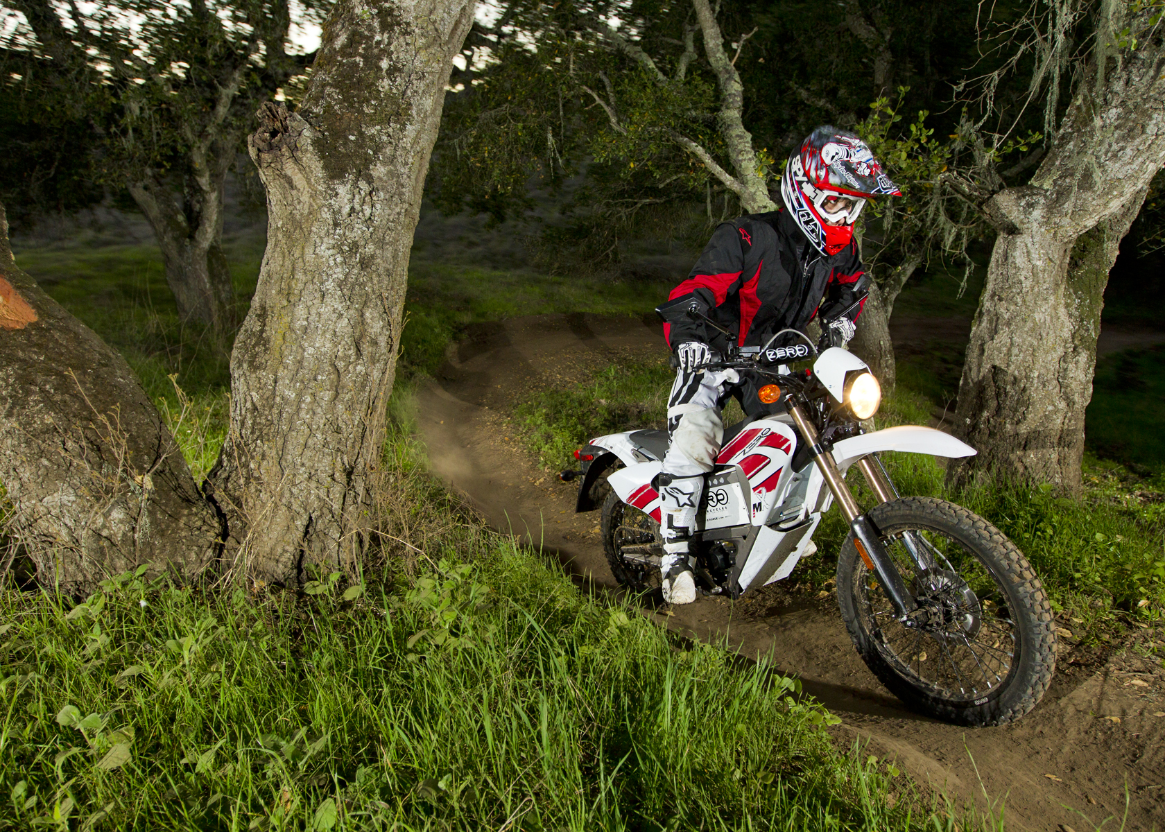 '.2011 Zero MX Electric Motorcycle: Dirt Path Through Oak Trees.'