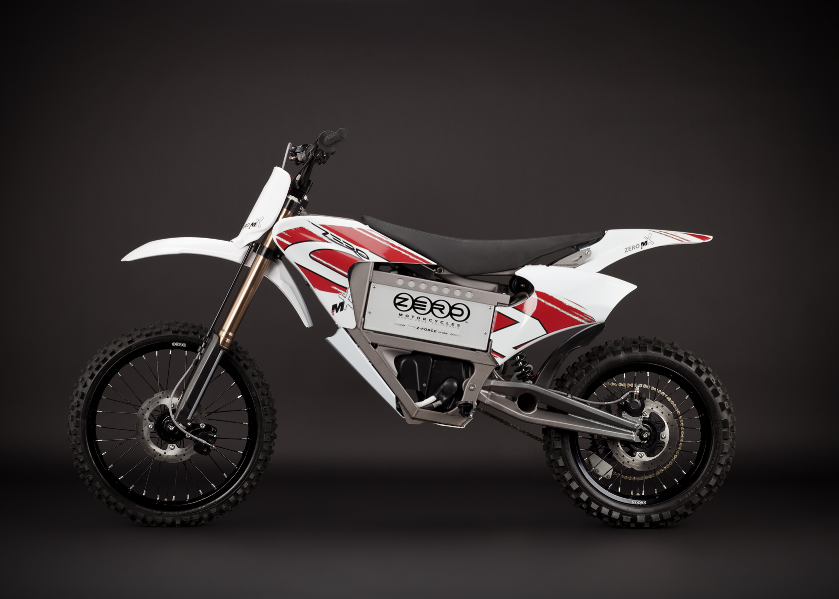 '.2011 Zero MX Electric Motorcycle: Left Profile, Dirt Model.'