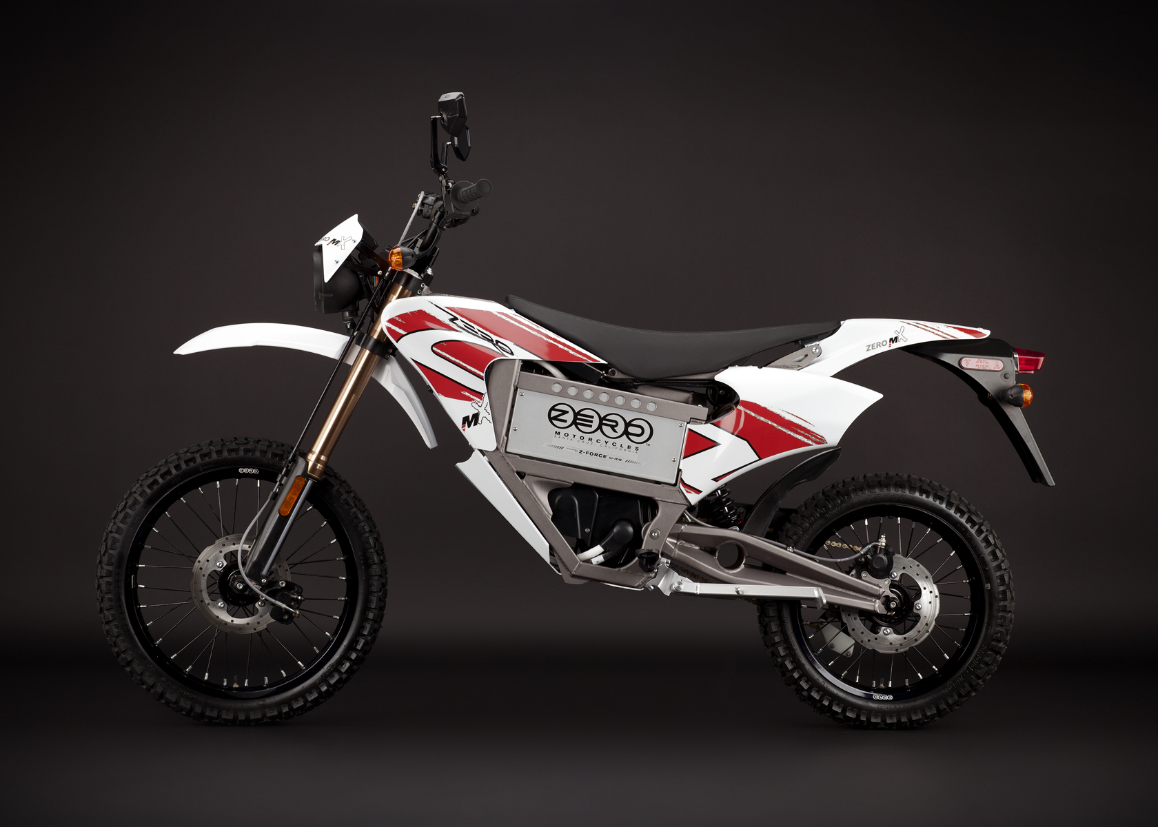 '.2011 Zero MX Electric Motorcycle: Profile Left, Street Legal Model.'