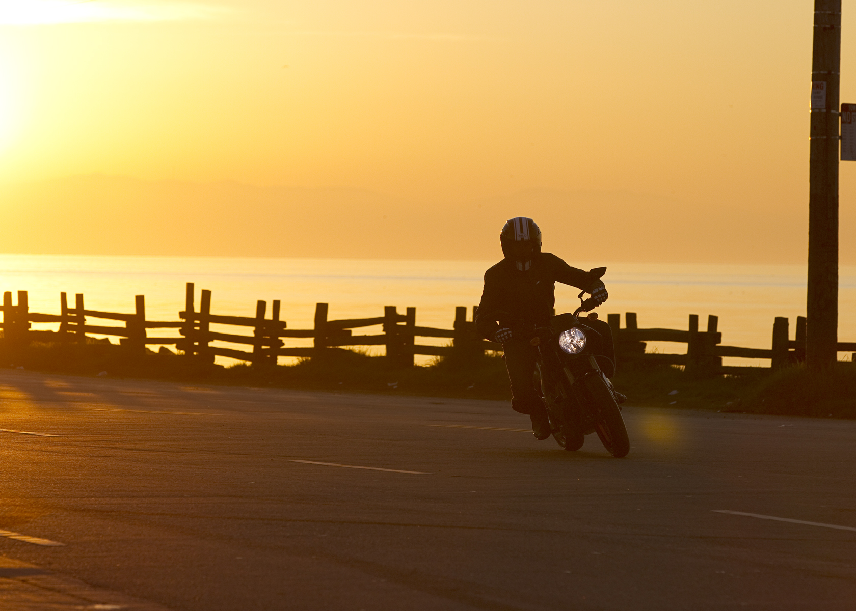 '.2011 Zero S Electric Motorcycle: Cruising at Sunset, Pacific Ocean View.'