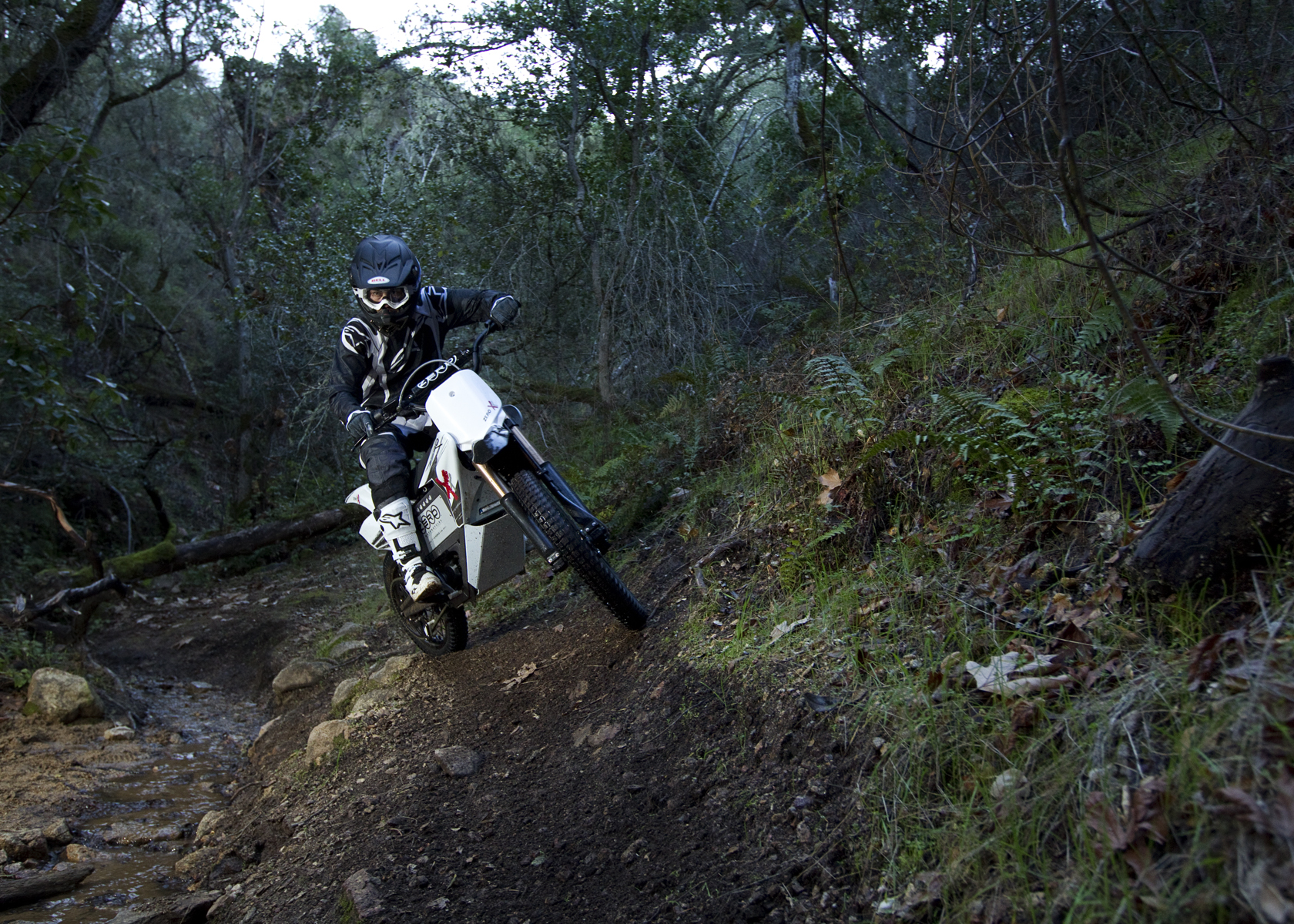 '.2011 Zero X Electric Motorcycle: Wooded Path by a Stream.'