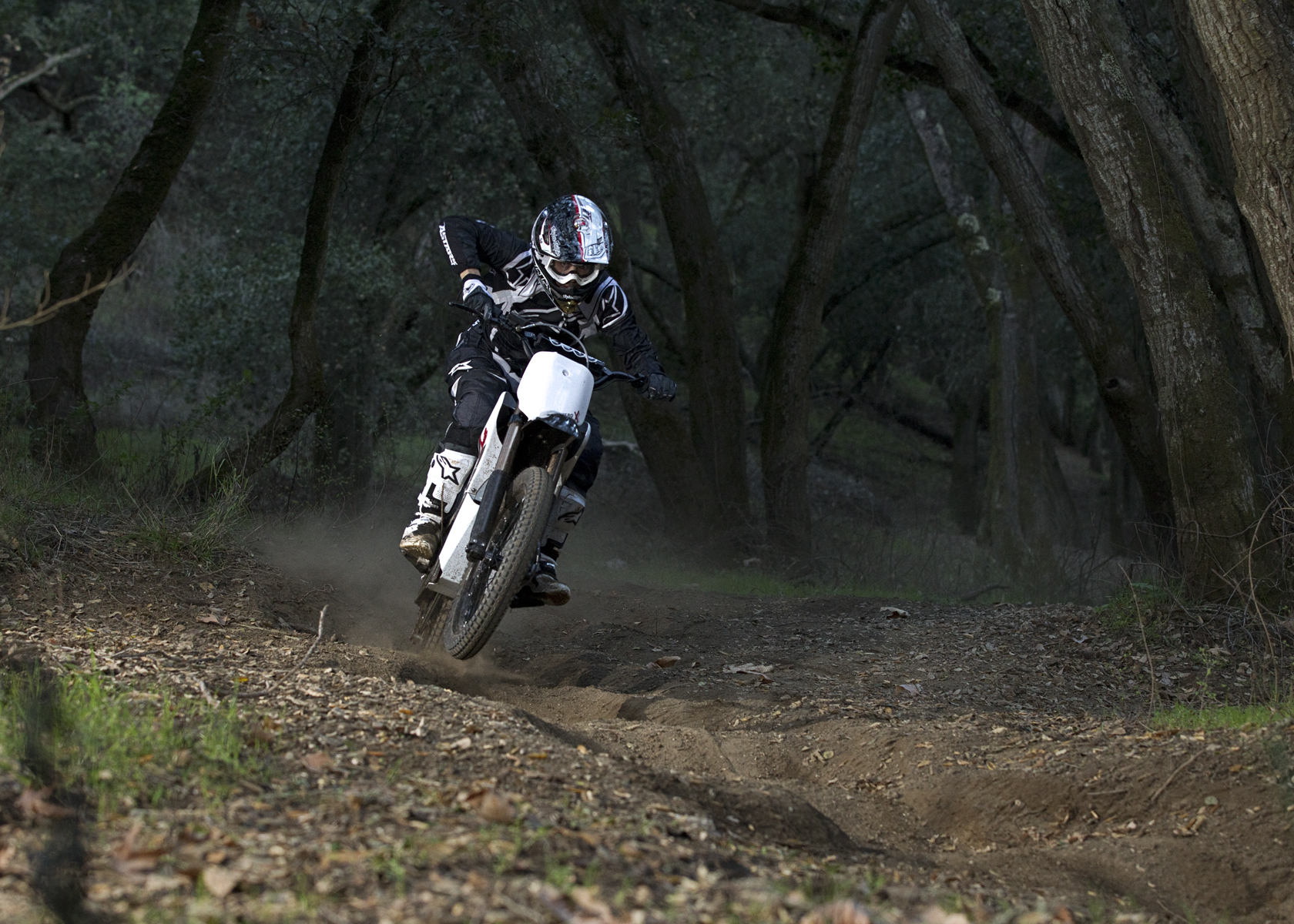 '.2011 Zero X Electric Motorcycle: Speeding through Ruts.'