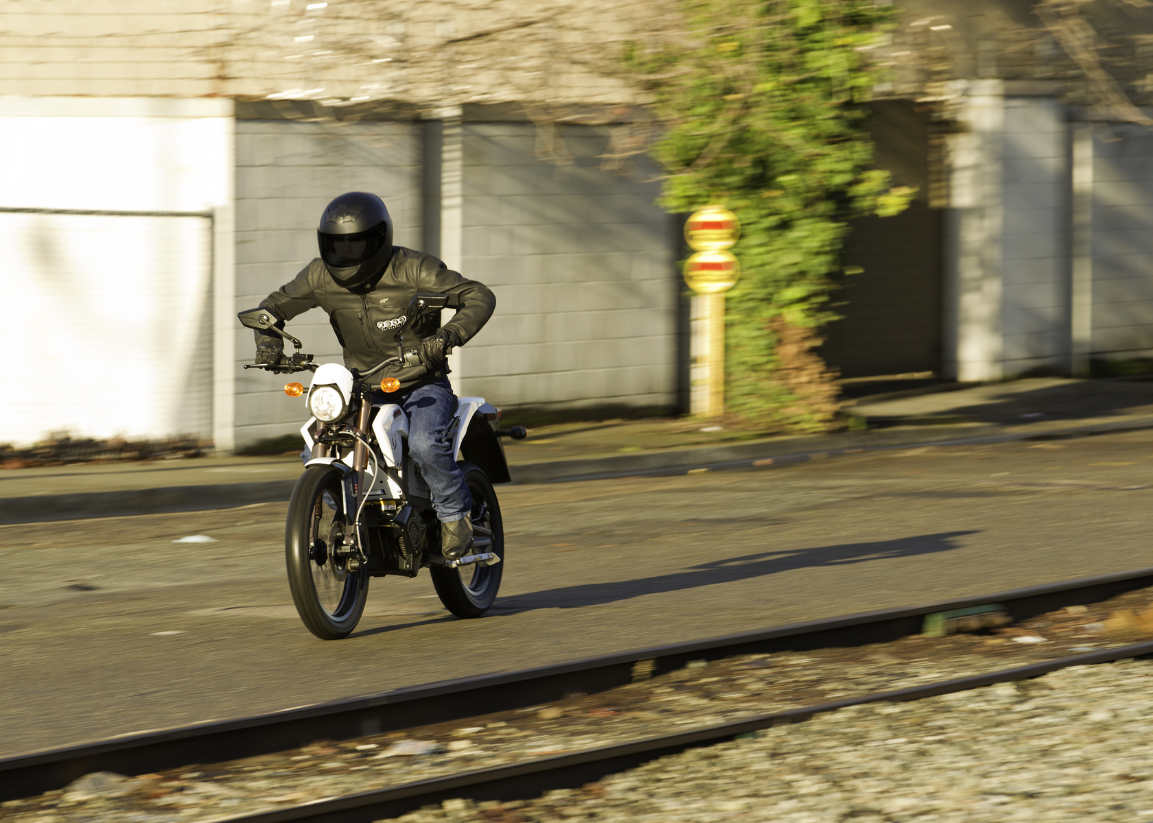'.2011 Zero XU Electric Motorcycle: In the City, by Railroad Tracks.'