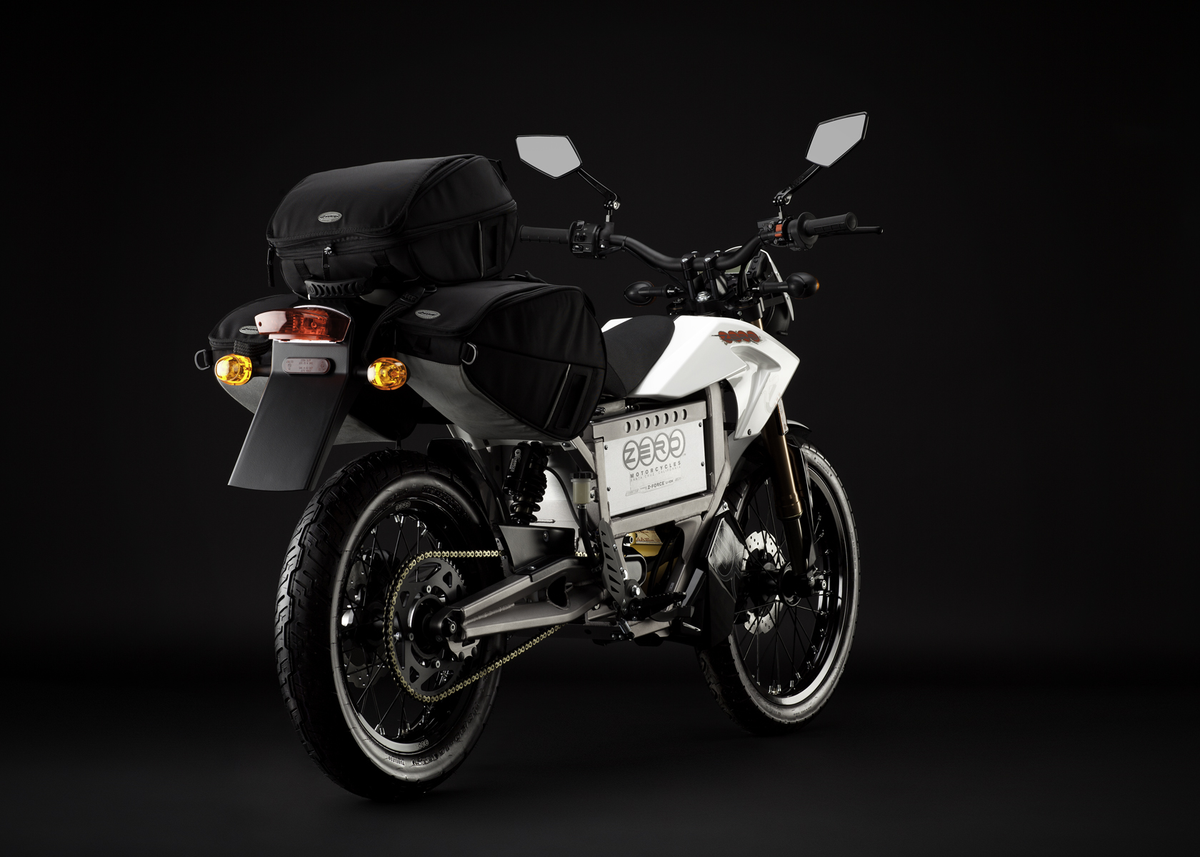 '.2011 Zero XU Electric Motorcycle: Angle Right, Rear View, with Side Bags.'
