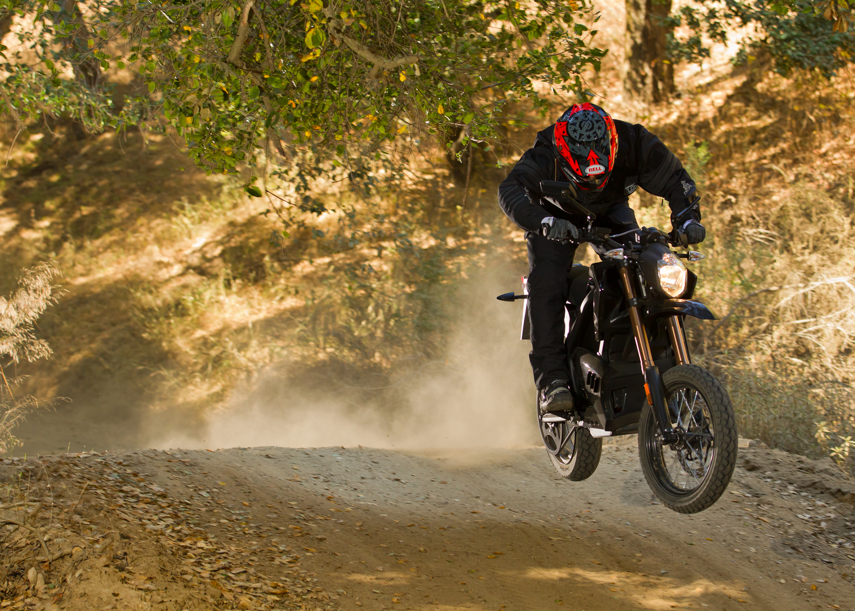 '.2012 Zero DS Electric Motorcycle: Charging Down a Dirt Road.'