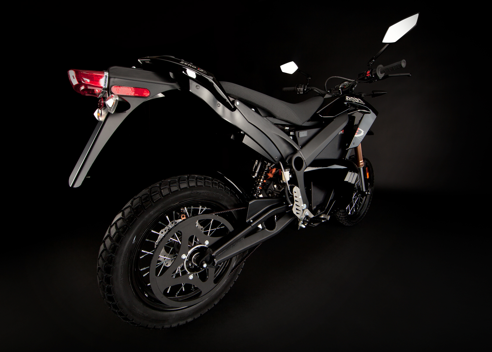 '.2012 Zero DS Electric Motorcycle: Black Angle Right, Rear View, Wide.'