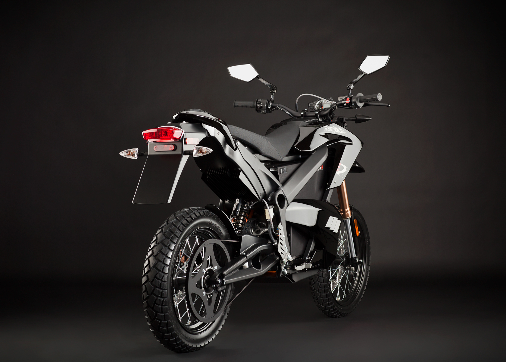 '.2012 Zero DS Electric Motorcycle: Black Angle Right, Rear View.'