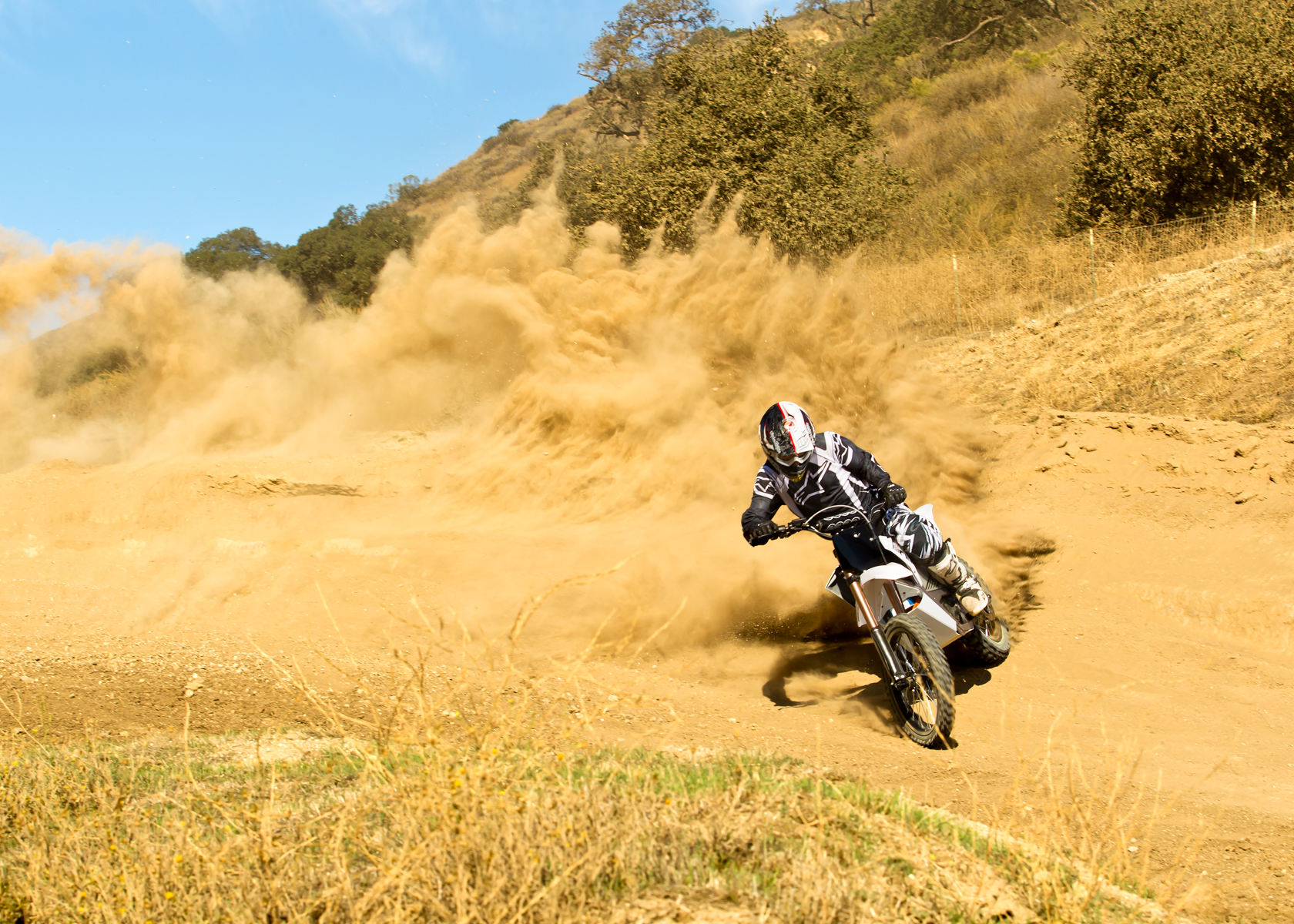 '.2012 Zero MX Electric Motorcycle: On a Dirt Road.'