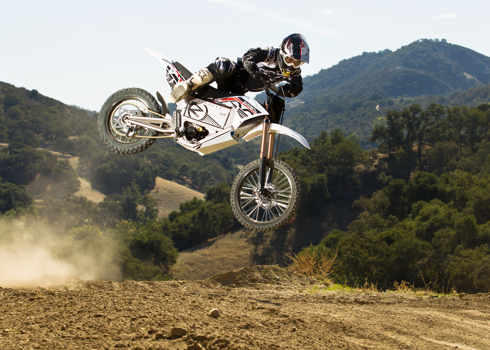 '.2012 Zero MX Electric Motorcycle: High Jump on Track.'