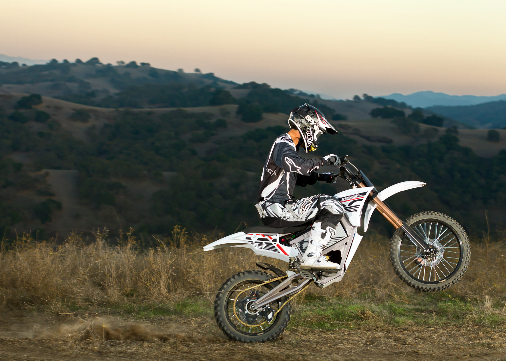 '.2012 Zero MX Electric Motorcycle: Wheelie.'