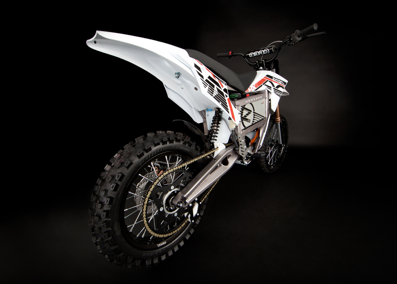 '.2012 Zero MX Electric Motorcycle: Angle Right, Rear View, Wide.'
