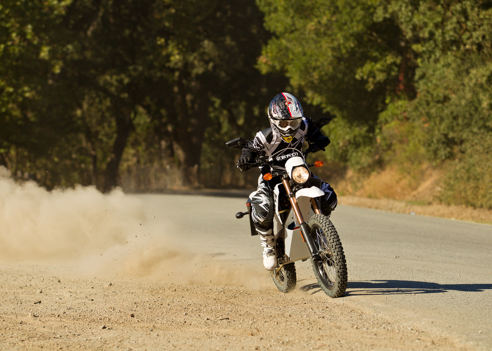 '.2012 Zero X Electric Motorcycle: Charging Down Dirt Road.'