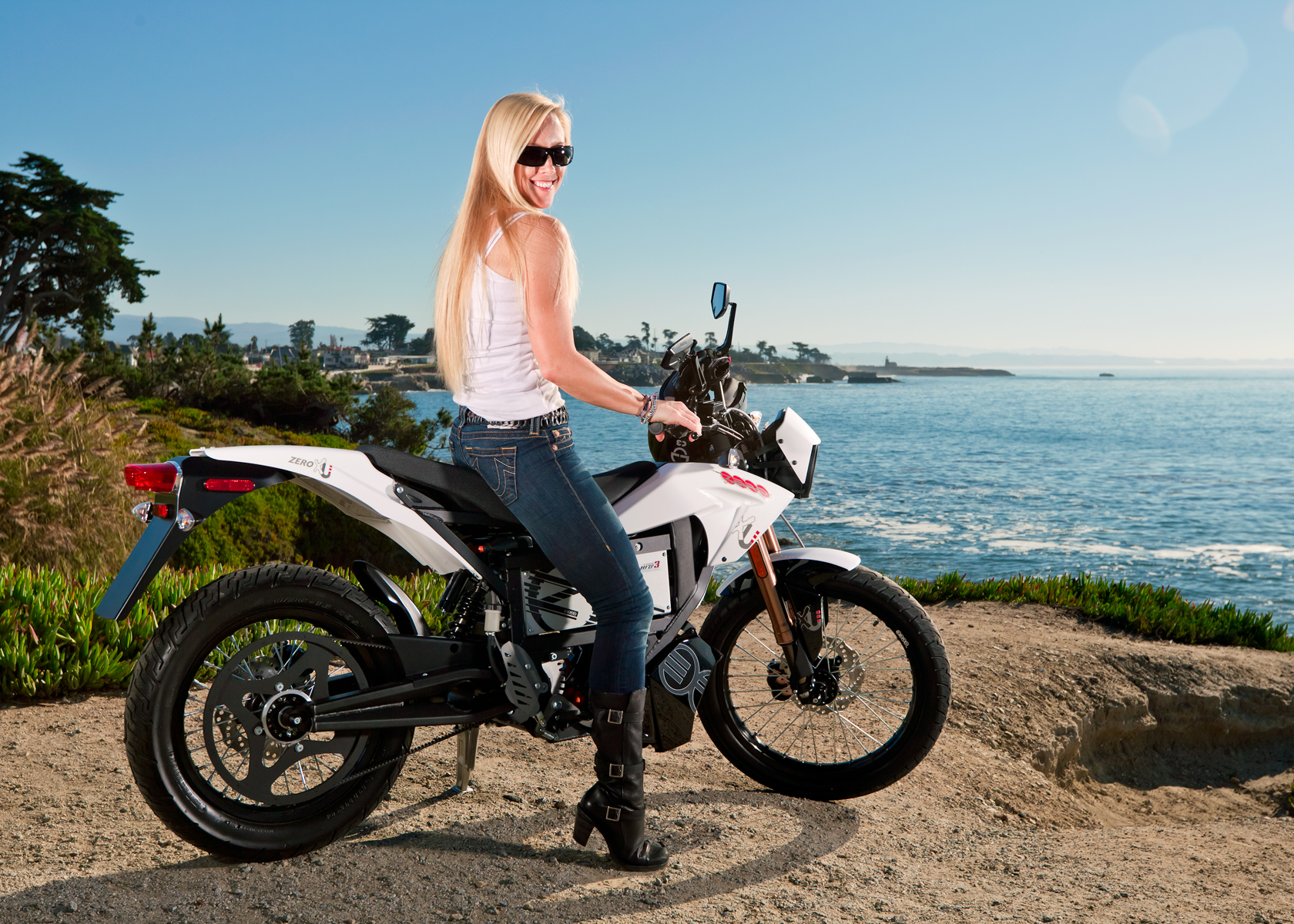 '.2012 Zero XU Electric Motorcycle: Profile with Rider, Pacific Ocean.'